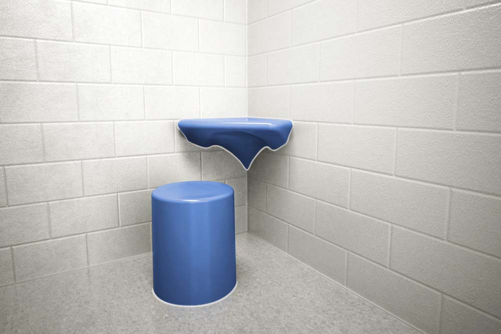 Round Stool with Corner Wall mounted Desk installed in Jail Cell